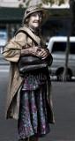 Very elderly lady clutching her bag