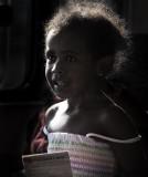 Little backlit girl on ferry