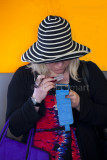 Woman in striped hat with magnifying glass