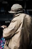 Elderly lady looking into bag
