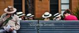 School girls in hats on bench