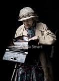 Very elderly lady looking into bag