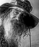 Man in hat at Quay mono