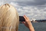Female tourist on Sydney Harbour