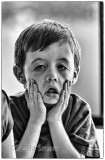 Little boy making face on ferry