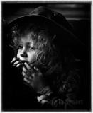 Little girl watching busker