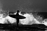 Anticipation - surfer silhouette in black and white