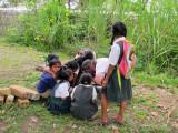 Children of Yukupari help Tom
