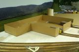 Cardboard mock-up in progress.   Note cars inside building.