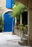blue door and garden