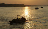 boats at sunset on Mekong River