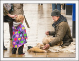 The Beggar, The Young Girl and a Ferret on a String