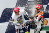 SEPANG, MALAYSIA - OCTOBER 25: Valentino Rossi (left) celebrates his win at the Shell Advanced Malaysian Motorcycle Grand Prix 2