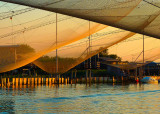 Huts and fishing nets at sunset