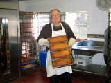 Father Augustine Foley With Freshly Baked Loaves