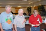 Sean Beckert, Don Meline and Steve Phillips checking numbers