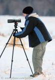 A photographer sets up despite freezing temperatures