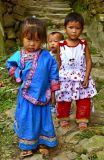 Three young Kam children.