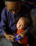 Kam child and grandmother.
