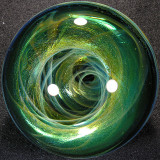This one begs to be seen in hand.  Wonderful depth to the vortex, and oh so shiny emerald green!