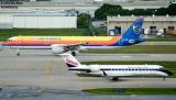 Delta Connection (Comair) CL-600-2B19 N967CA and Air Jamaica A321 6Y-JMD airline aviation stock photo
