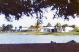 1976 - ground level view of home we bought (left, red roof) and Dr. Potter's home (right)