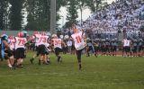 kyle kicks the ball away