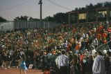 large homecoming crowd in brown stadium