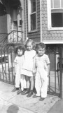 L to R: Cousins Susan & Marilyn, & Richard in front grandma Anna & grandpa Louis' (mother's side) house - Brooklyn (1946)