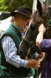 Doug Sutherland helping with tack