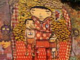 Close-up of Os Gemeos's graffiti/mural on wall outside Coney Island train station