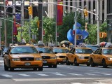 New York Taxis with Cubed Curve in background