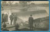 Men inspecting Dam