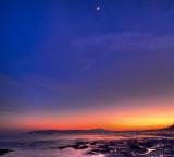 Moon rising over Douglas bay
