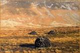 IRELAND - CO.GALWAY - TURF STACKED BENEATH MAUMTURK MOUNTAINS