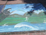 Chalk murals on the sidewalk outside the Museo