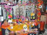 An altar for Dia de los Muertos, where lots of food and gifts were left.