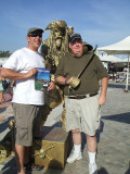 Our friend and my hubby w/ a golden pirate