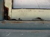 Graffito on the window frame