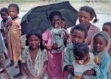 Children under Umbrella.