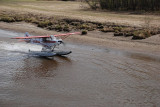 OUR TRIP STARTED WITH A BUSH PILOT TAKING OFF  AND LANDING ALONG SIDE THE BOAT