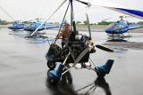 Pilot Mark Swan prepares hang glider for flights