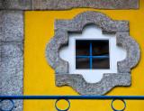Window in yellow wall