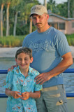 Father - Son moment on the sunset cruise