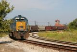 Passing the decaying L&N depot, train Q265 moves to the east bound CSX Texas line on its journey to Louisville