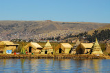 Huts and teepee-like dwellings are built on floating rafts of vegetation