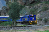 To reach Machu Picchu, you can either hike the Inca Trail or take the train