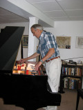 A month later John arrives to tune the piano