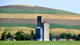tall grain tower and horizontal landscape