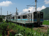 Local train pulling up beside Lake Kizaki